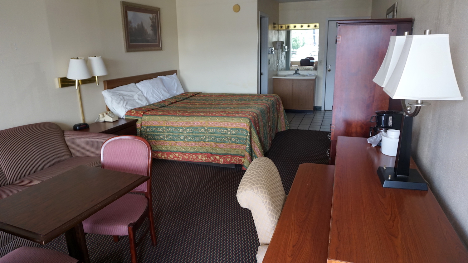 Hotel room with king bed at River Place Inn