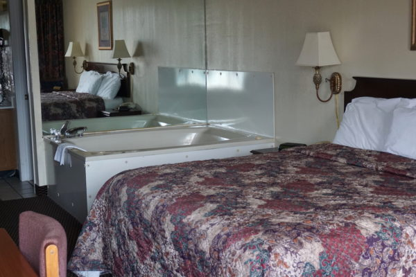 Hotel room with king bed and jetted tub in Pigeon Forge Tn